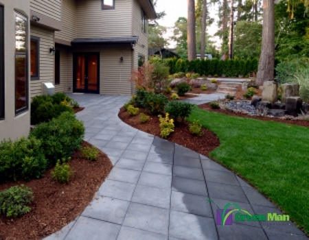 Completed landscape with grey stone walkway and mulch