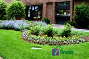 Commercial mowing property with a flower bed