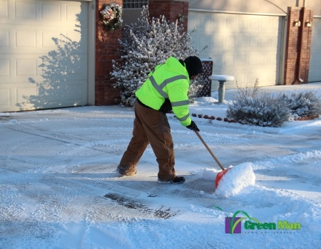 Snow shoveler providing snow removal services in Longmont.