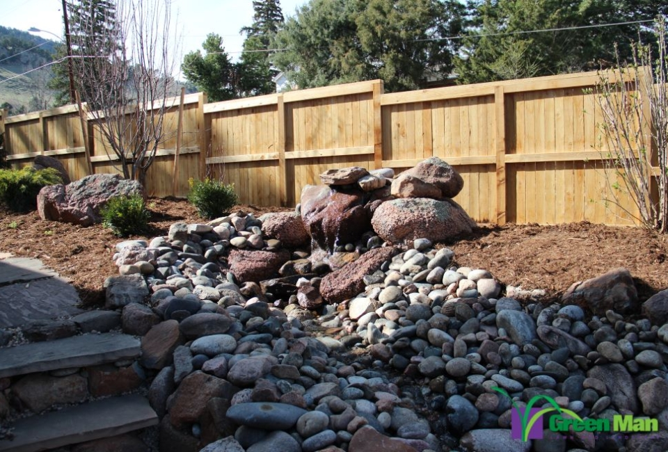 A pond and waterfall installation project in North Boulder.