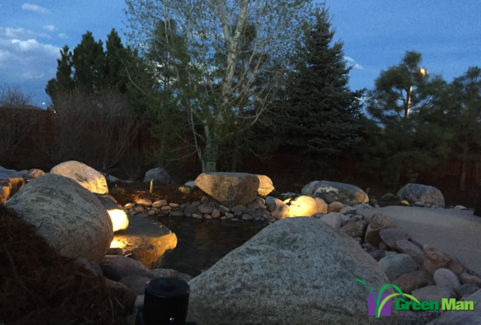 A pond and waterfall installation project in North Longmont.